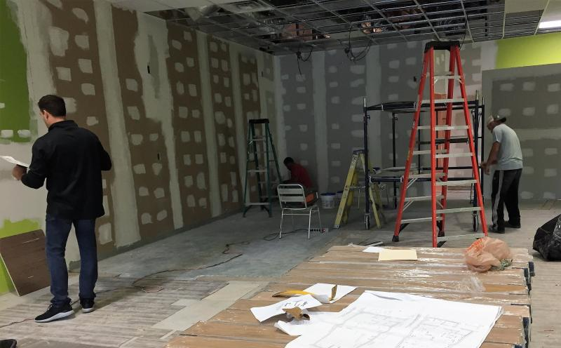 Whitelam Books' interior is under construction in a space that formerly sold frozen yogurt.