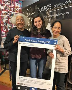 Sweepstakes winner Marissa Wais, center, enjoys congratulations from Source Booksellers owner Janet W. Jones, left, and bookseller Alyson Jones Turner, right.